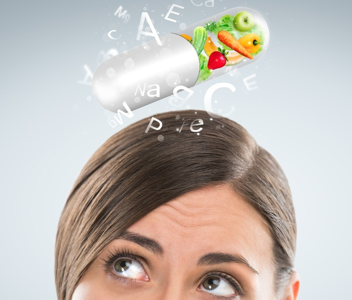 Healthy life concept. Woman with vitamins overhead